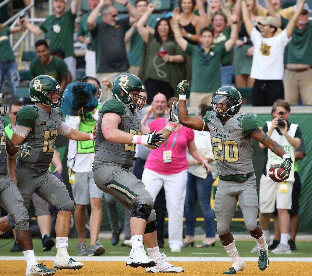 Baylor running back Craig Williams (20) celebrates his touchdown against Kansas State in the second half of an NCAA college football game, Saturday, Oct. 6, 2018, in Waco, Texas. Baylor won 37-34. (Rod Aydelotte/Waco Tribune Herald, via AP)
