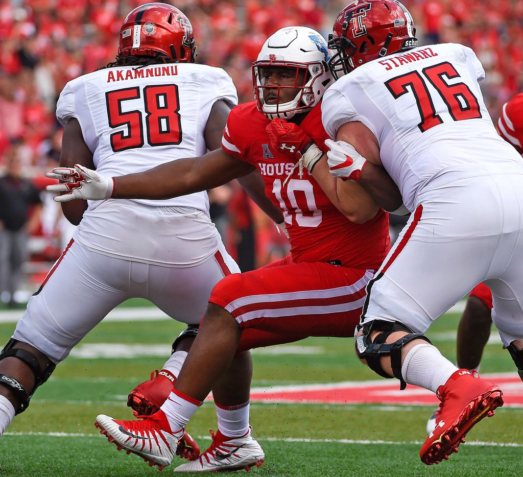 Houston defensive tackle Ed Oliver (10) is blocked by Texas Tech offensive lineman Paul Stawarz (76) during the second half of an NCAA college football game, Saturday, Sept. 23, 2017, in Houston. Texas Tech won 27-24. (AP Photo/Eric Christian Smith)