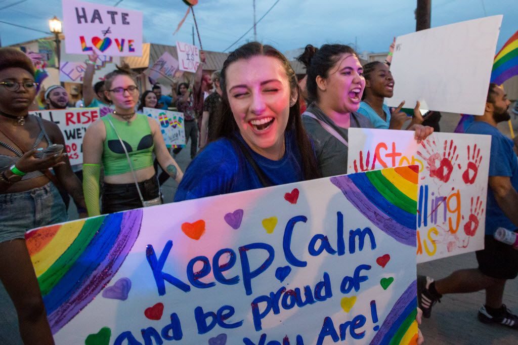 Hayley Ford (center left), of Denton, Texas, marches with signs during the Queer Bomb Dallas procession march though in Deep Ellum streets on June 25, 2016 in Dallas. (Ting Shen/The Dallas Morning News)