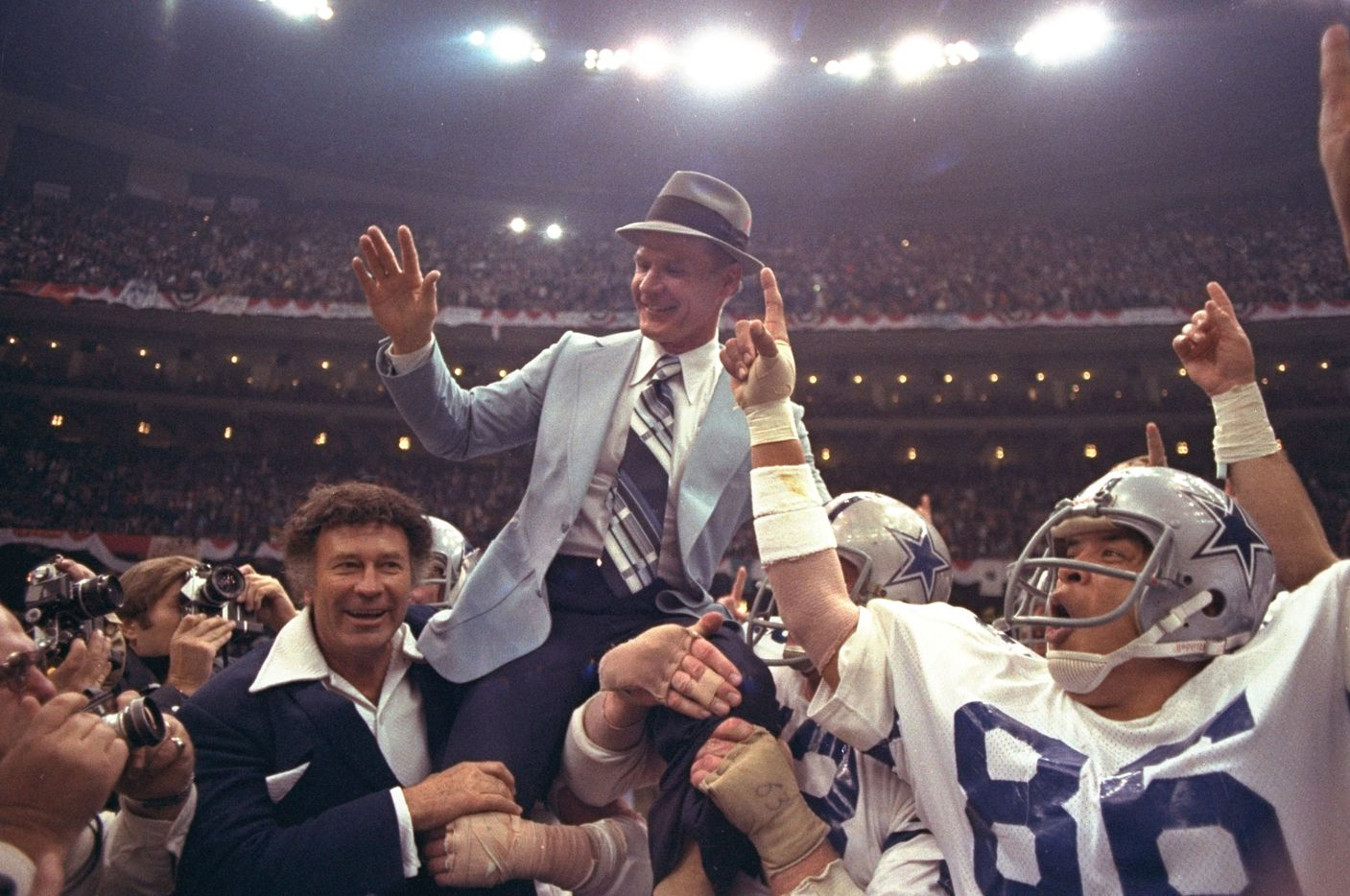 Dallas Cowboys head coach Tom Landry is given a victory ride on the shoulders of his players after the Cowboys defeated the Denver Broncos 27-10 in Super Bowl XII at the New Orleans, Louisiana Super Dome, on Jan. 15, 1978.