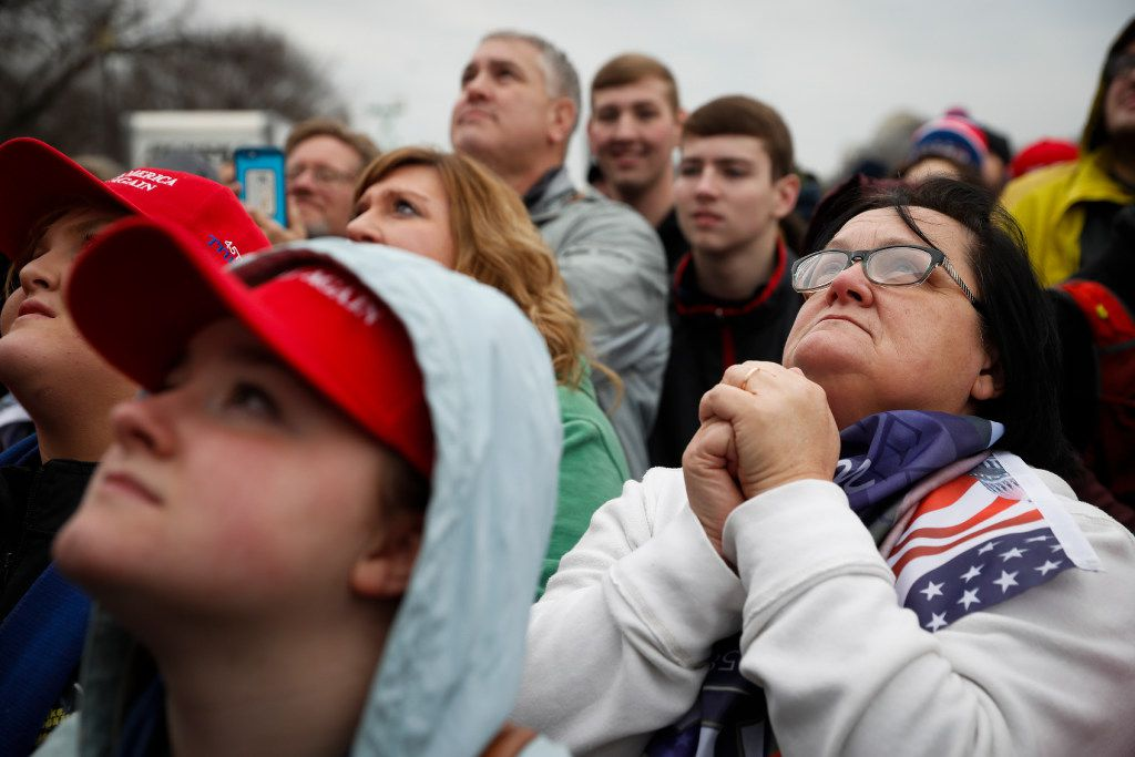 Supporters on the National Mall react to the inauguration of US President Donald Trump. (John Minchillo/The Associated Press)