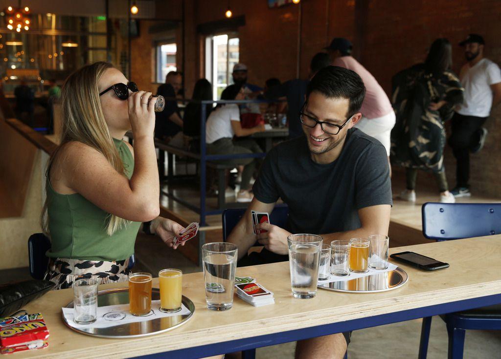 Kalah Blankenship and Jordan Hostetler of Dallas play a friendly game of Uno at Westlake Brewing Co.