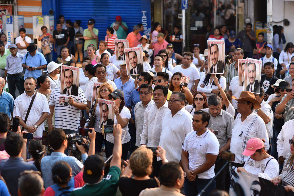 """Residents of Minatitlan, Veracruz state, march on April 23, 2019, during a protest against the killing of 13 people after a group of unidentified gunmen opened fire on a party on April 19. The Secretariat of Public Safety said the gunmen arrived at a family reunion asking to see someone named """"El Becky' -- the owner of a local bar -- before opening fire and killing 13 and injuring four others. Veracruz is plagued with organised crime and bloody gun battles frequently erupt between rival drug gangs."""