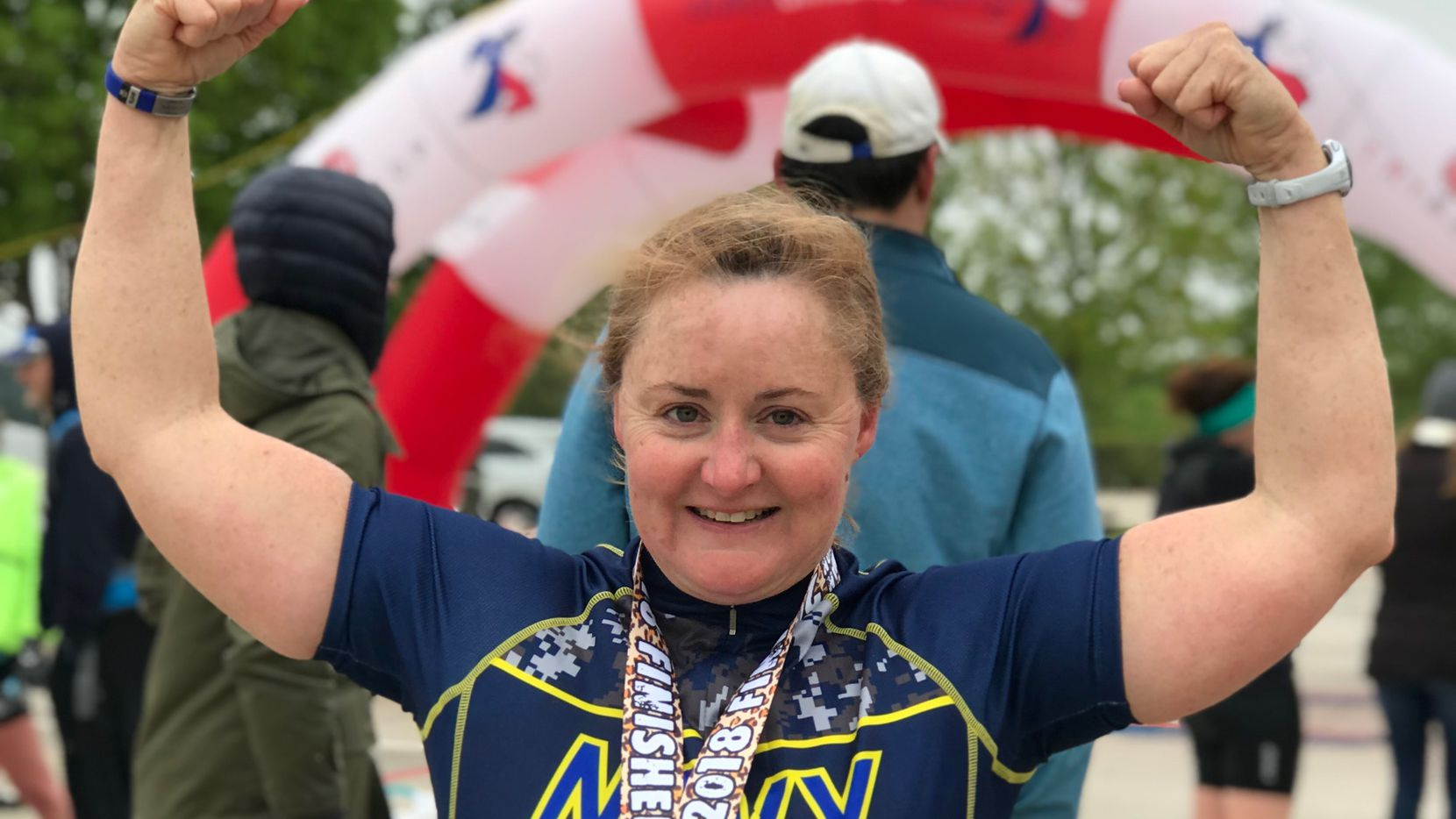 Emily Susan Law, 49, celebrates after a triathlon in April 2018.