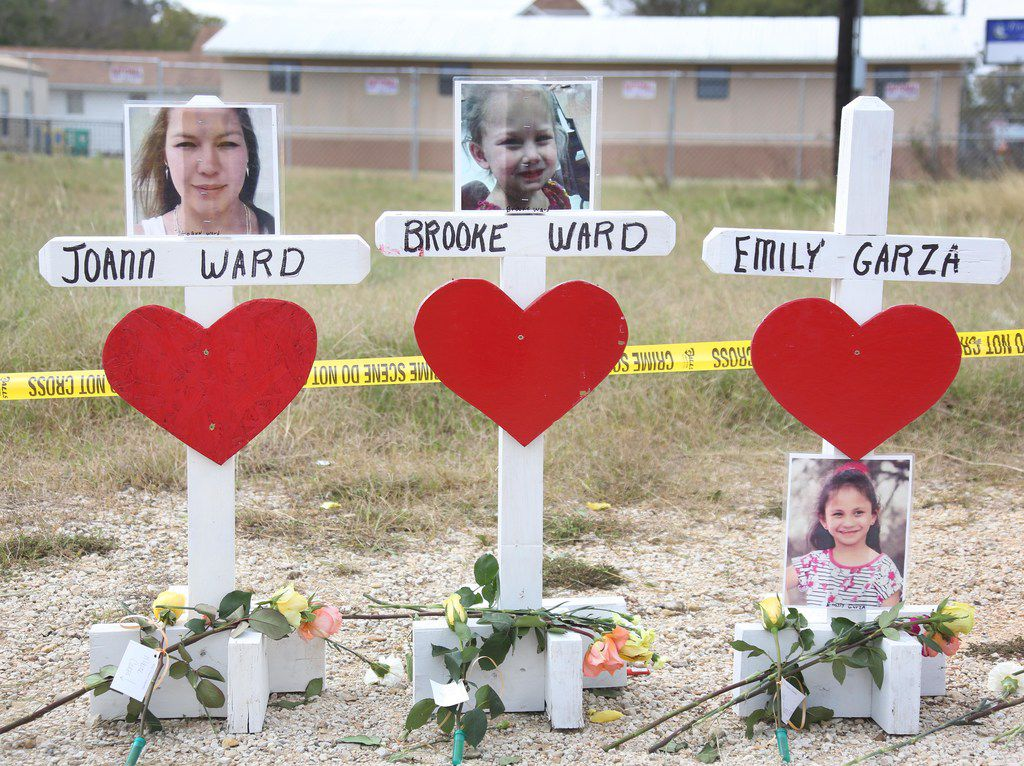 Wooden crosses honor the 26 shooting victims near First Baptist Church of Sutherland Springs off U.S. Highway 87.