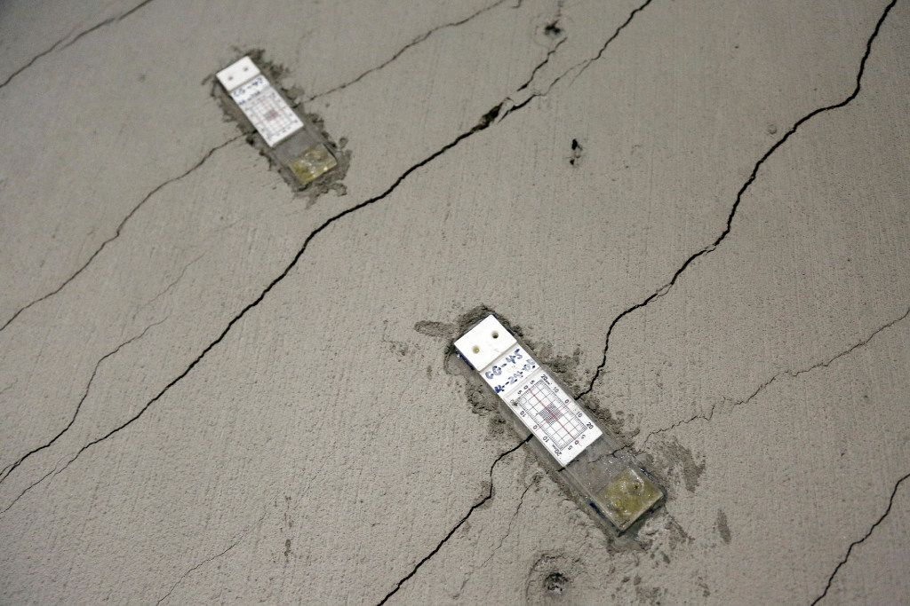 In this photo taken Monday, Oct. 3, 2016, stress gauges are placed along a wall with floor-to-ceiling cracks in the parking garage of the Millennium Tower in San Francisco.(AP Photo/Eric Risberg)