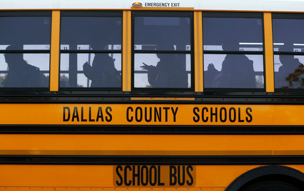 Buses drop students off at W.E. Greiner Exploratory Arts Academy in Dallas on Oct. 25, 2017.