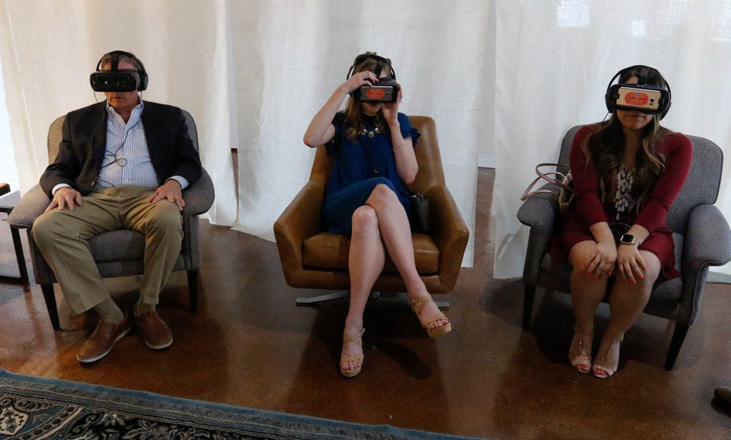 Spencer Falls (left), ACT board member, and Carly Biggers and Carolina Avila watches a 360-degree video at ACT's Generation Justice event at the Commerce Event Center in Deep Ellum on April 12, 2018.