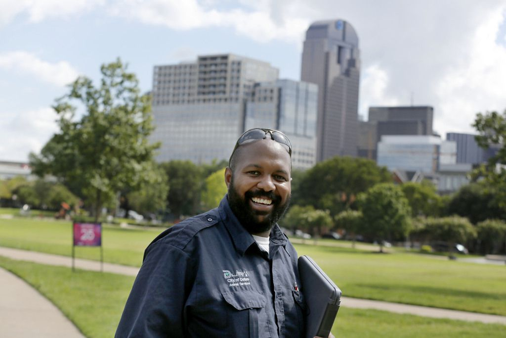 Dallas Animal Services field officer Allen Davis patrols Griggs Park near downtown to educate dog owners on Sept. 4.