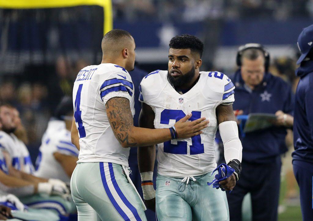 Dallas Cowboys' Dak Prescott, left, and Ezekiel Elliott (21) talk on the sideline during an NFL football game against the Detroit Lions on Monday, Dec. 26, 2016, in Arlington, Texas.