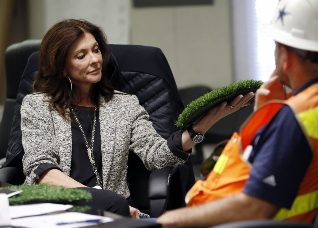 Charlotte Jones Anderson (left) Executive Vice President and Chief Brand Officer for the Dallas Cowboys looks over one of the two options for artificial grass to use that Stadium General Manager, Jeff Stroud (Center) of the Dallas Cowboys brought in in the stadium at the Dallas Cowboys new headquarters at The Star in Frisco, on Tuesday, May 3, 2016. The Star a joint project with the City of Frisco is scheduled to open in August. (Vernon Bryant/The Dallas Morning News)