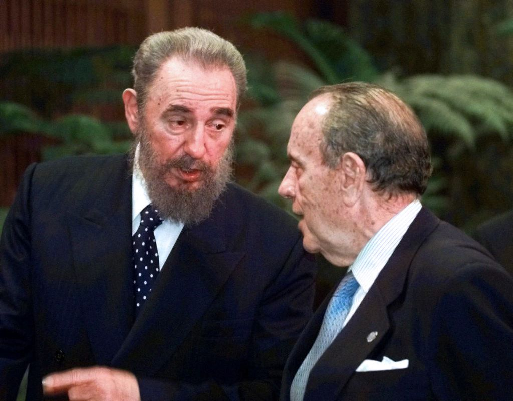 In this Oct. 28, 1998 file photo, Cuban President Fidel Castro (L) speaks with the president of the Spanish region of Galicia, Manuel Fraga, at the Palacio de la Revolucion in Havana during Fraga's six-day official visit to Cuba.