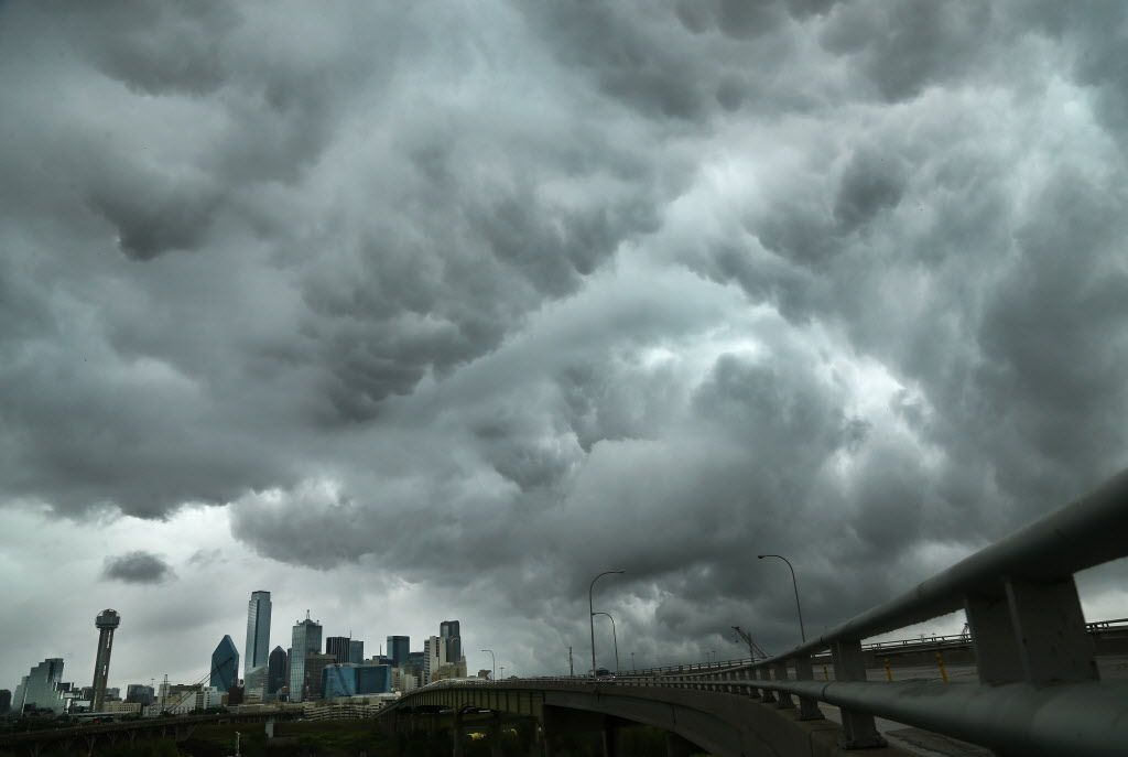 Dark storm clouds, seen near downtown Dallas, signify battles brewing between Texas insurance companies, trial lawyers, state lawmakers, regulators and consumers in 2017. The Watchdog reports. (Tom Fox/Staff Photographer)