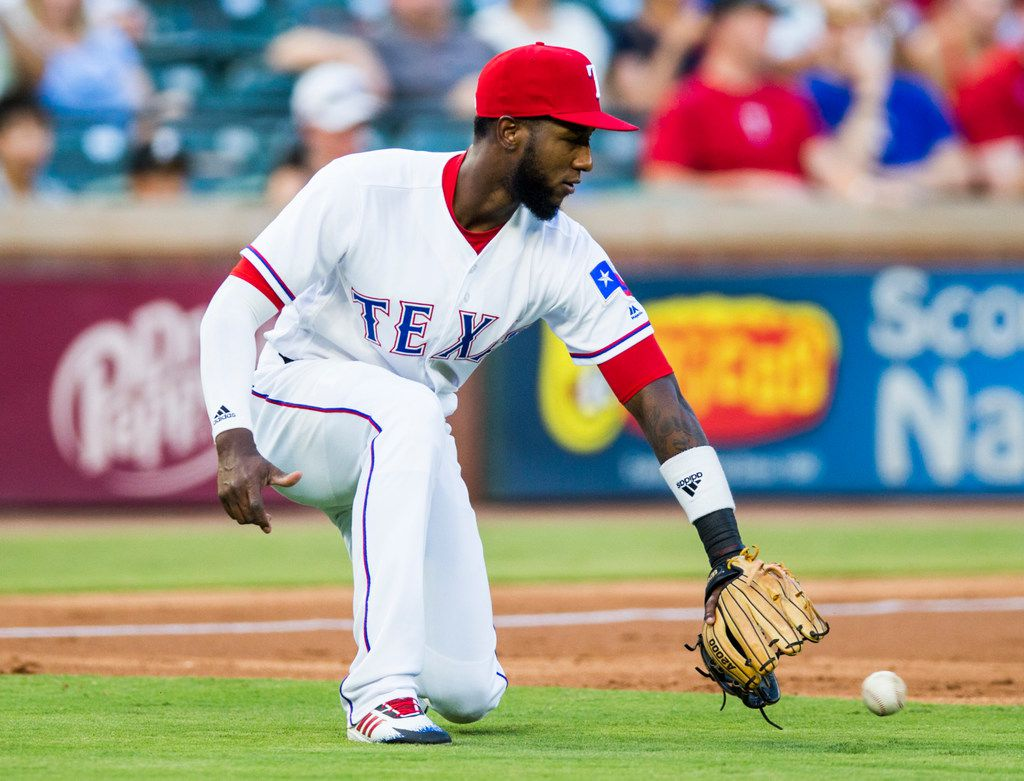 Texas Rangers shortstop Jurickson Profar (19) catches a ball during the first inning of an MLB game between the Texas Rangers and the Los Angeles Angels on Thursday, August 16, 2018 at Globe Life Park in Arlington. (Ashley Landis/The Dallas Morning News)