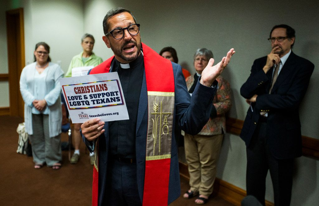 Rev. Dr. Neil G. Cazares, senior pastor at the Cathedral of Hope in Dallas, leads an interfaith prayer in a gathering room for people who came to the capitol to voice their opinions on the bathroom bill at a public hearing on the fourth day of a special legislative session on Friday, July 21, 2017 at the Texas state capitol in Austin, Texas. (Ashley Landis/The Dallas Morning News)