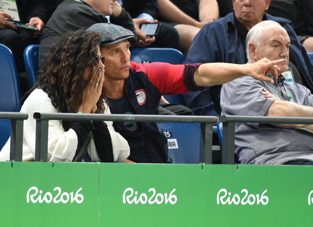 US actor Matthew McConaughey and wife Camila Alves watch the Men's round Group A basketball match between Australia and USA at the Carioca Arena 1 in Rio de Janeiro on August 10, 2016 during the Rio 2016 Olympic Games.