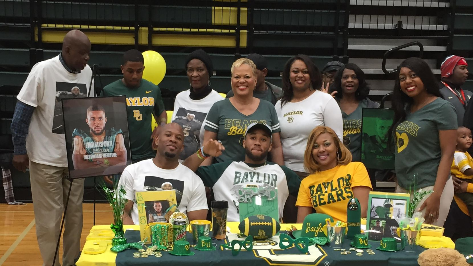 DeSoto defensive back Byron Hanspard Jr. was surrounded by his family at the school's signing day ceremony Wednesday. He was honored for signing with Baylor during the early signing period in December.