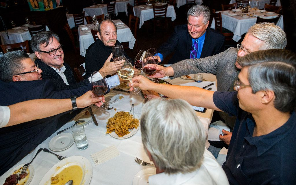 Al Biernat (at the head of the table), former manager of the Palm restaurant, toasts with other current and former staff on June 20, 2017. The restaurant will close its doors on June 30.