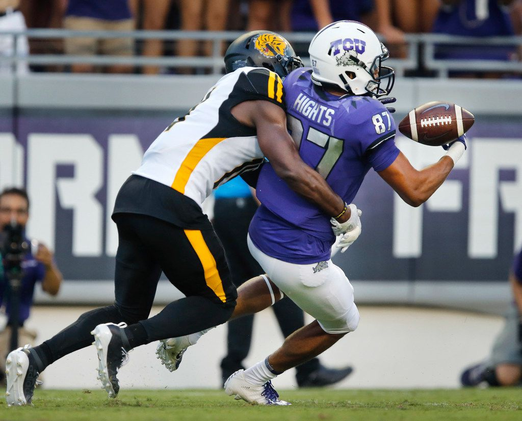 TCU Horned Frogs wide receiver TreVontae Hights (87) looses the ball while running for the end zone during a first quarter reception at Amon G. Carter Stadium in Fort Worth Texas, Saturday, August 31, 2019. Arkansas-Pine Bluff Golden Lions defensive back Blake Conner (14, left) picked up the loose fumble.
