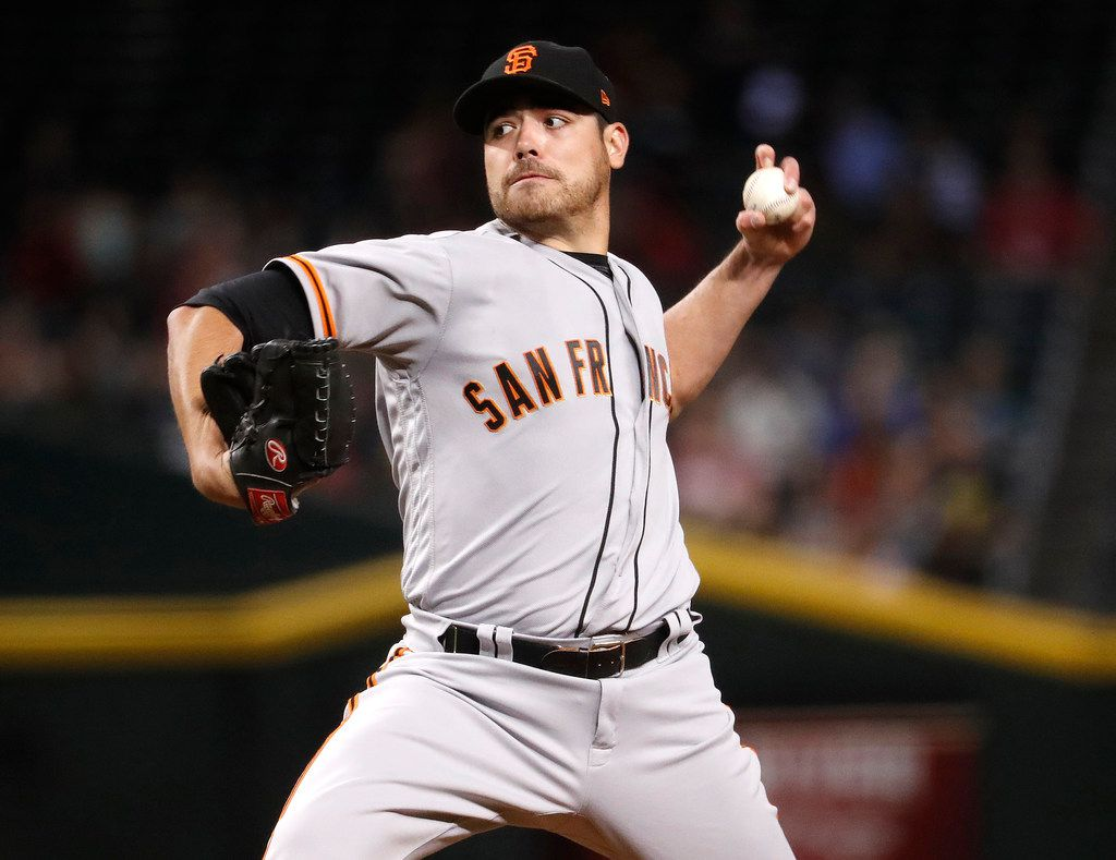 FILE - In this Tuesday, Sept. 26, 2017 file photo, San Francisco Giants starting pitcher Matt Moore throws to an Arizona Diamondbacks batter during the first inning of a baseball game in Phoenix. A person with direct knowledge of the agreement says the San Francisco Giants are trading left-hander Matt Moore to the Texas Rangers for prospects. The swap was pending a physical, the person said Friday, Dec. 15, 2017 speaking on condition of anonymity because neither club had announced the deal. (AP Photo/Matt York, File)