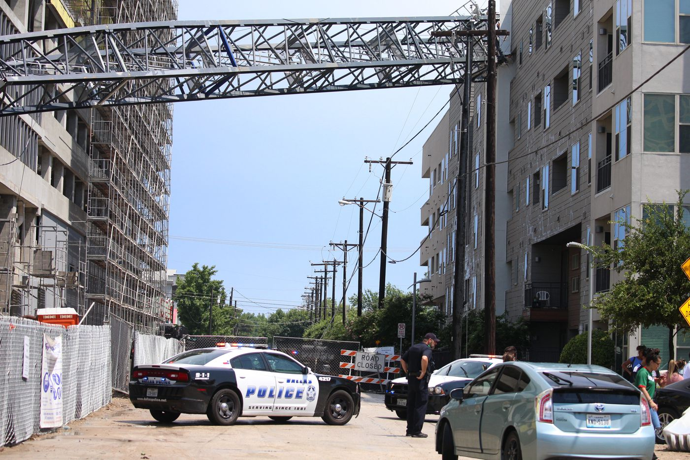 Officials responded after a crane collapsed into the Elan City Lights apartments in Dallas on Sunday. Injuries were reported when storms pummeled parts of North Texas.