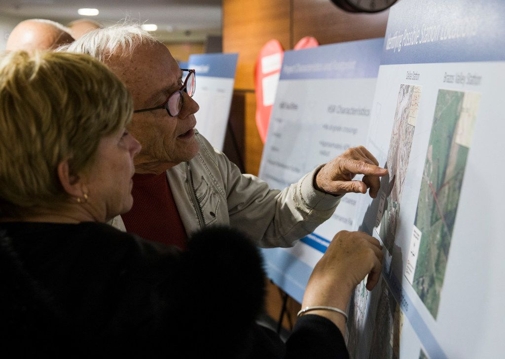 Susan Anderson and James Mannos look at maps of possible station locations during an open house for people to view plans and talk to company and corporate officials about a $15 billion Dallas to Houston high-speed rail line on Monday at Wilmer-Hutchins High School in Dallas. (Ashley Landis/The Dallas Morning News)