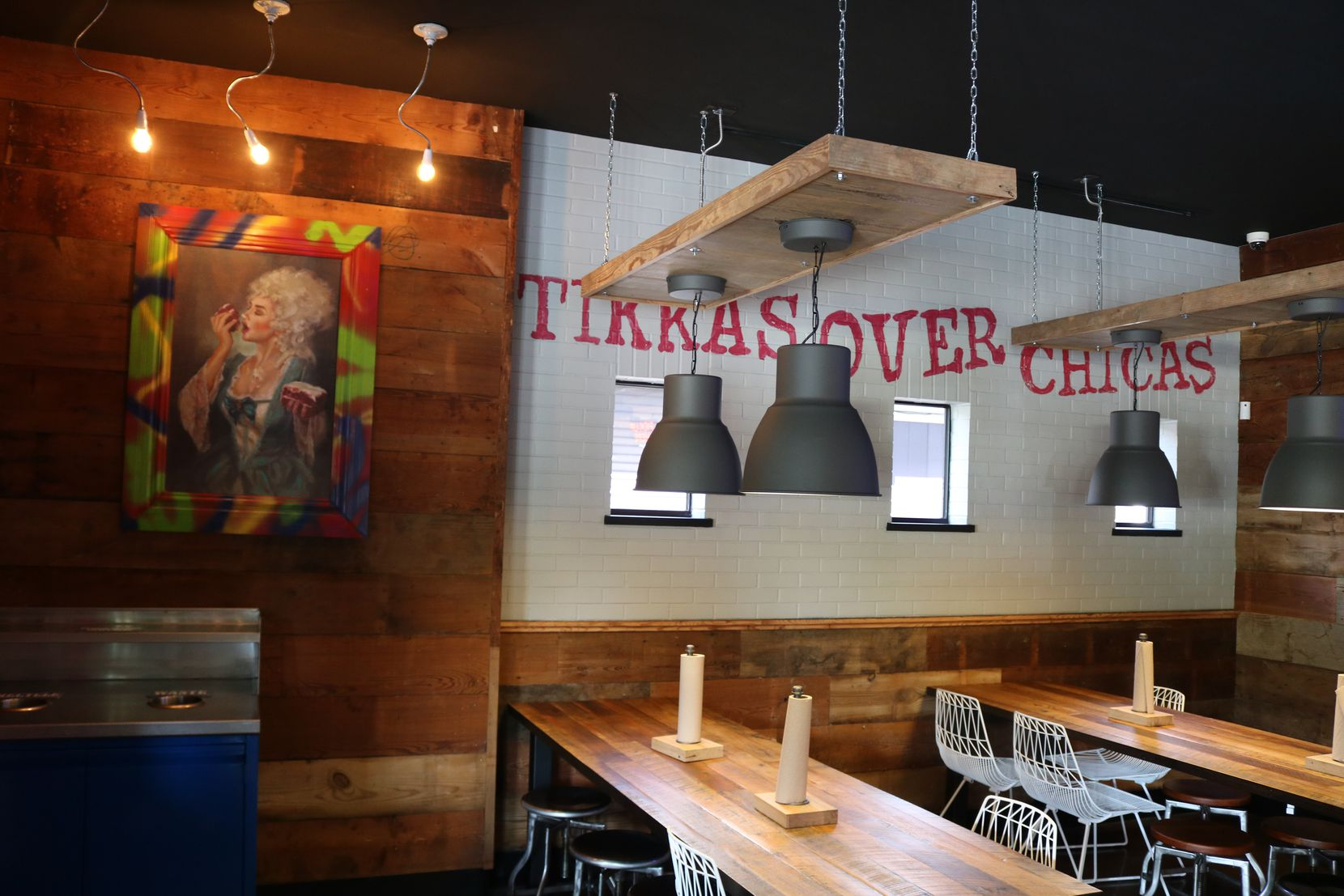 """Next to a painting of Marie Antoinette eating red velvet cake -- Velvet Taco's signature dessert -- is a catchphrase at the new Uptown Dallas restaurant: """"Tikkas over chicas."""""""
