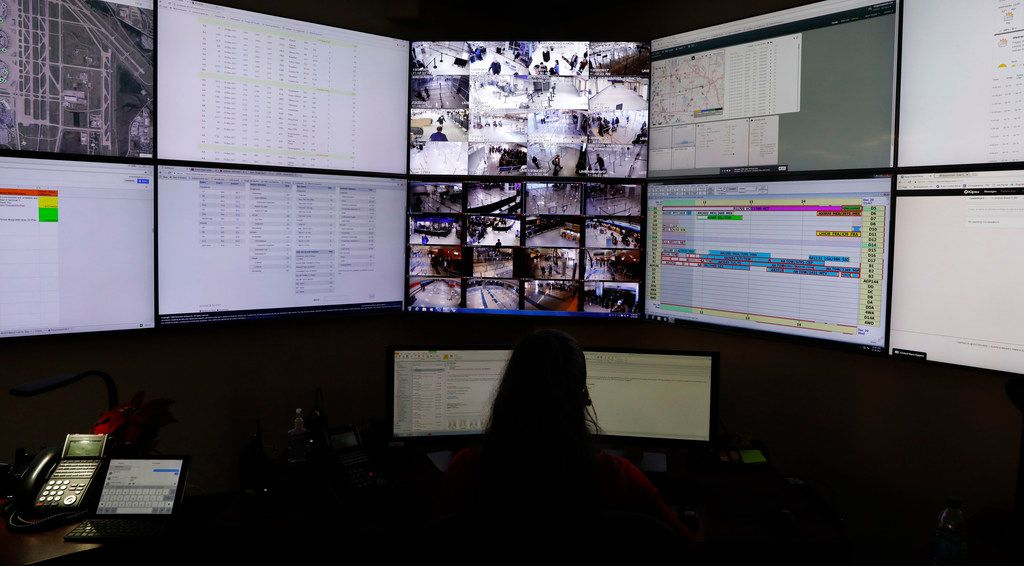 DFW International Airport customer service center personnel watched monitors in Terminal D on Dec. 22, 2017.