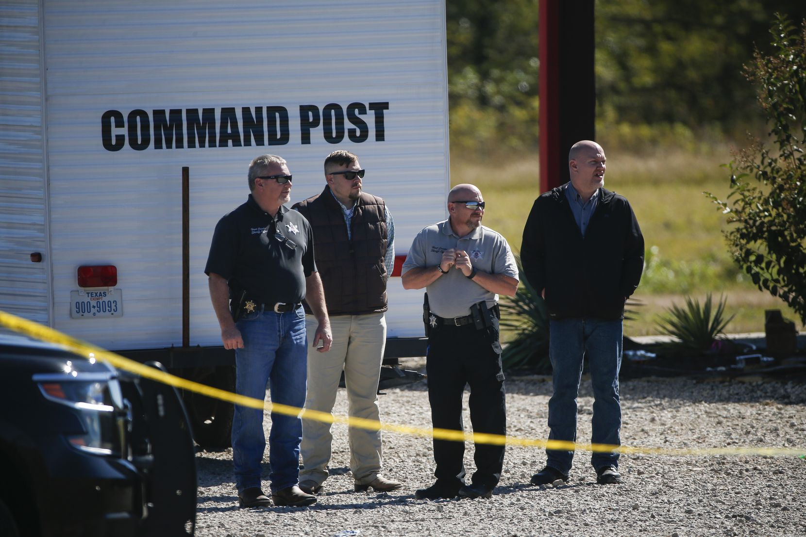 Investigators work a crime scene Sunday after a shooting at The Party Venue on Highway 380 in Greenville.