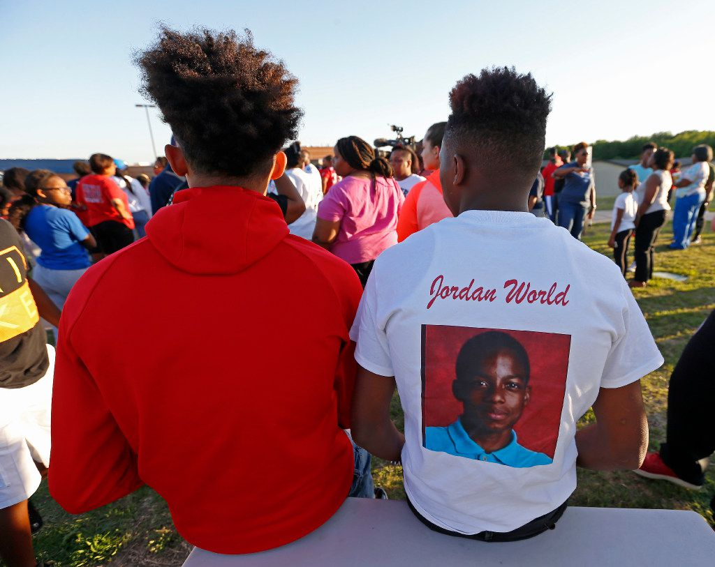 Alandre Henderson (right) wears a shirt in memory of Jordan Edwards during a vigil at Gentry Elementary School in Mesquite on Monday. Henderson said he and Jordan had been friends since they were six years old. Edwards was shot and killed by a Balch Springs police officer Saturday night.