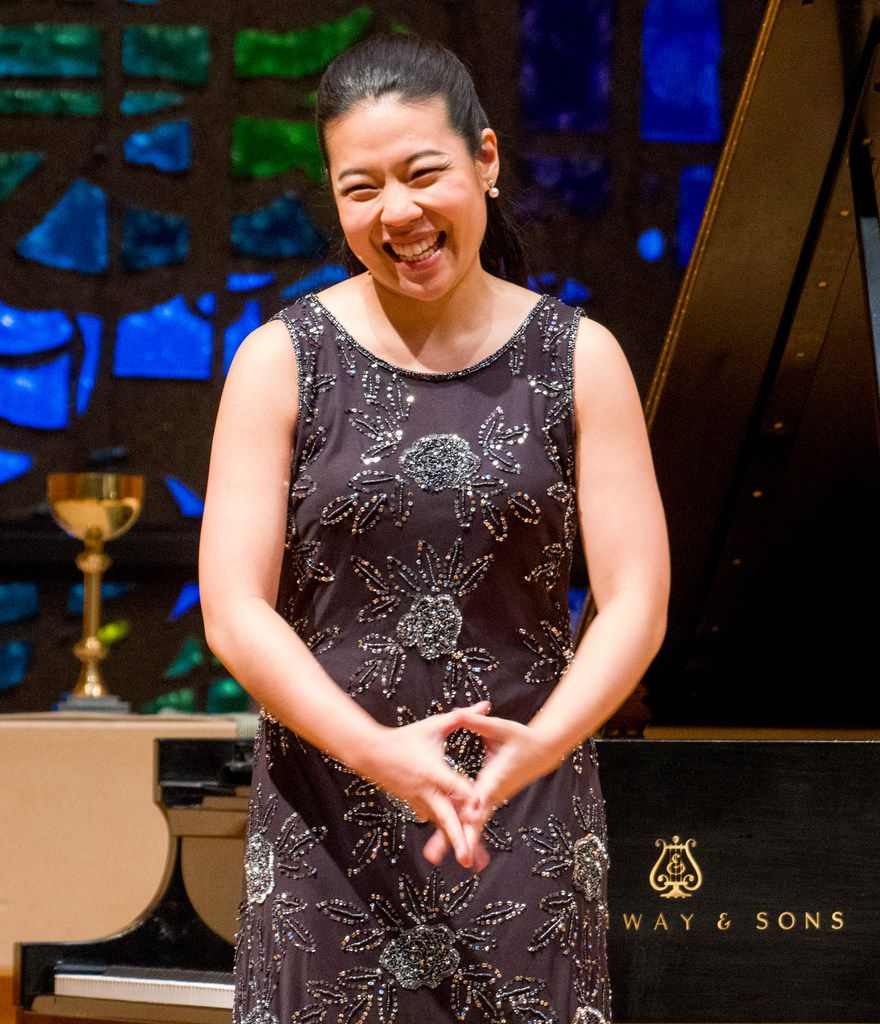 Van Cliburn International Piano Competition silver medalist Joyce Yang acknowledges applause before performing.