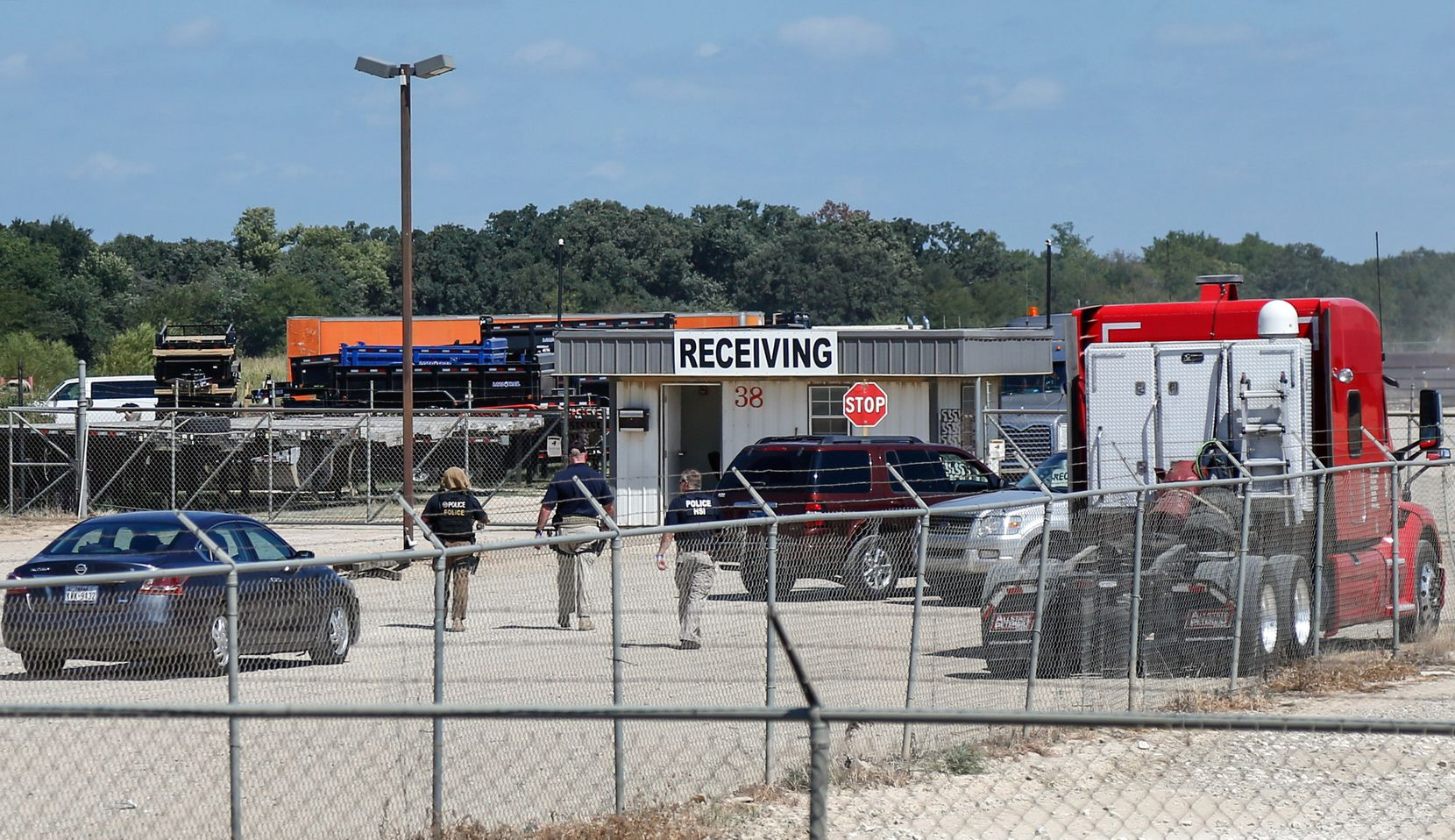 U.S. Immigration and Customs Enforcement agents are seen at the receiving gates of Load Trail, a Sumner-based business agents raided for undocumented workers in 2018. (Lora Arnold/Paris News)