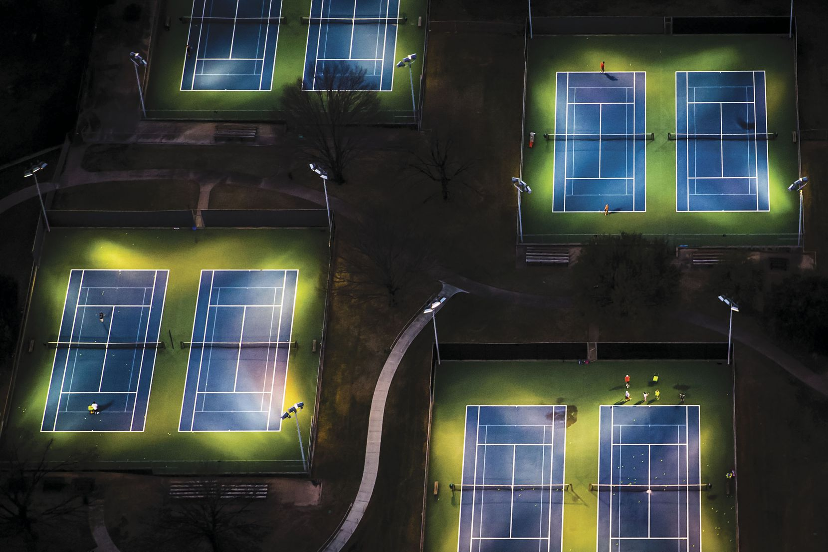 Nighttime Nadals and Navratilovas hit the courts at the Samuell Grand Tennis Center.
