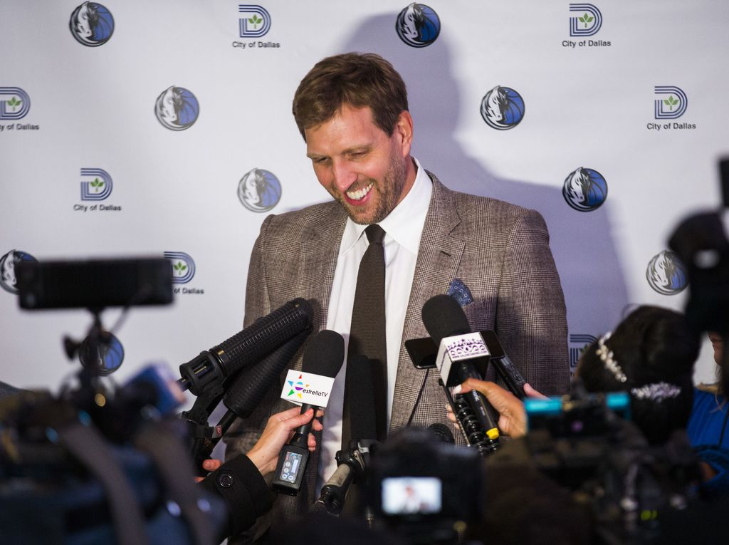 Retired Dallas Mavericks player Dirk Nowitzki answers questions from reporters after unveiling a street sign with his name on Wednesday, October 30, 2019 outside American Airlines Center in Dallas. The street in front of the arena was renamed Nowitzki Way.