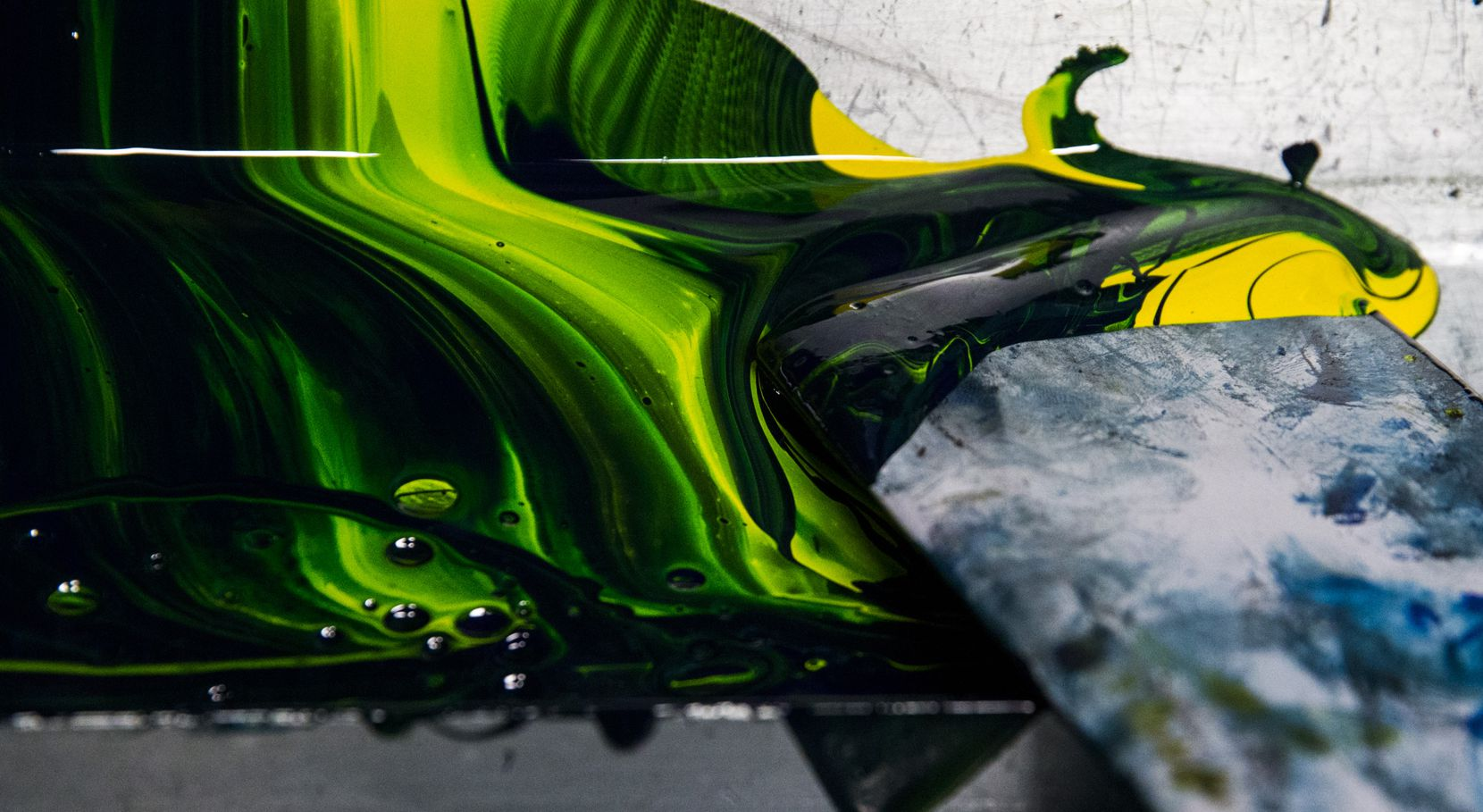 Color ink collects in a trough. (Ashley Landis/The Dallas Morning News)