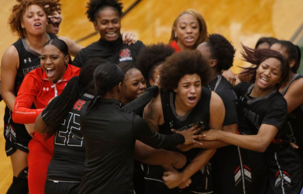 Cedar Hill forward Destinee McDowell (12) is mobbed by teammates after sinking a jump shot at the buzzer to give Cedar Hill a 44-43 victory over Desoto. Cedar Hill, raked first in the state, and Desoto, ranked number 2, played their District 7-6A girls basketball game at DeSoto High School in DeSoto on January 18, 2019. (Steve Hamm/ Special Contributor)