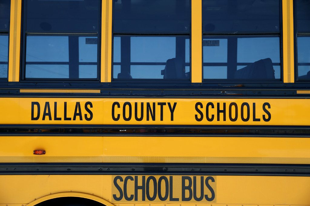 A school bus sits in the parking lot at the Dallas County Schools headquarters in Dallas.