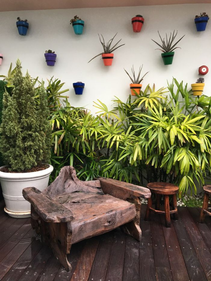 Planters in a spectrum of colors can help liven up your outdoor space, the Scout Design Studio team says.