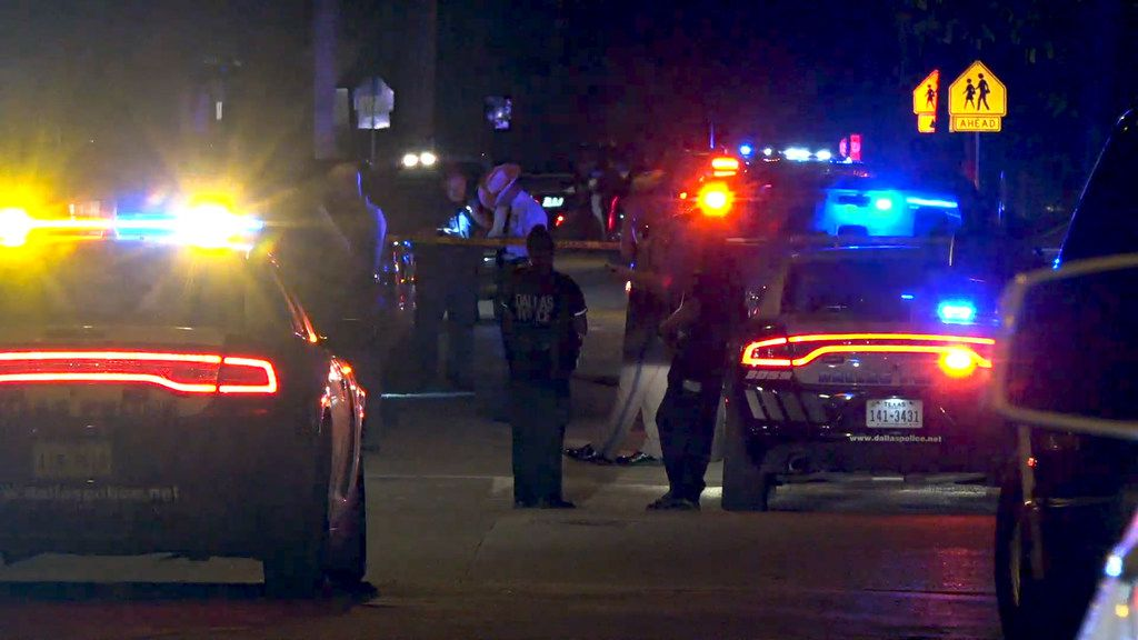 Dallas police officers and Department of Public Safety troopers meet outside of a house on the 4200 block of Jamaica Street in Dallas, Saturday night Aug. 17, 2019. DPS troopers fatally shot a driver who authorities say pulled a gun on them in South Dallas.