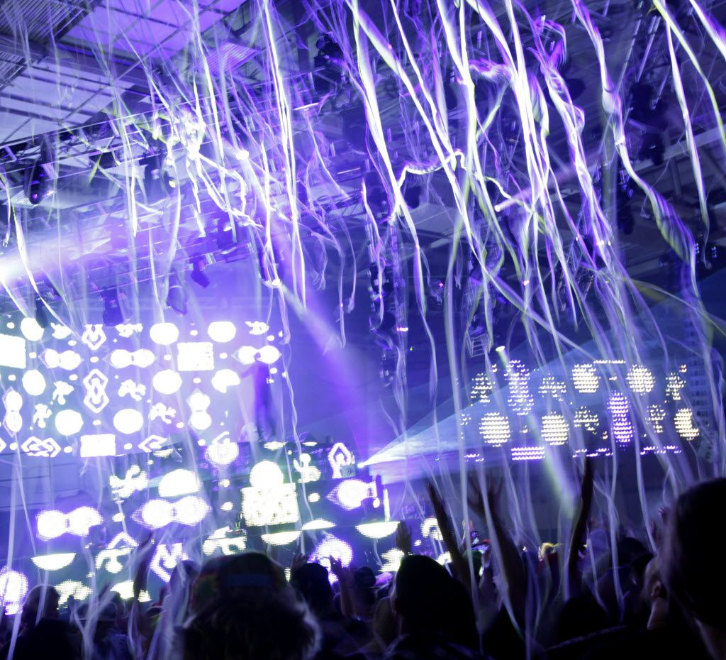 Guests dance as streamers fall onto the crowd during the Lights All Night festival at the Dallas Convention Center in Dallas, TX, on Dec. 26, 2014. (Jason Janik/Special Contributor)