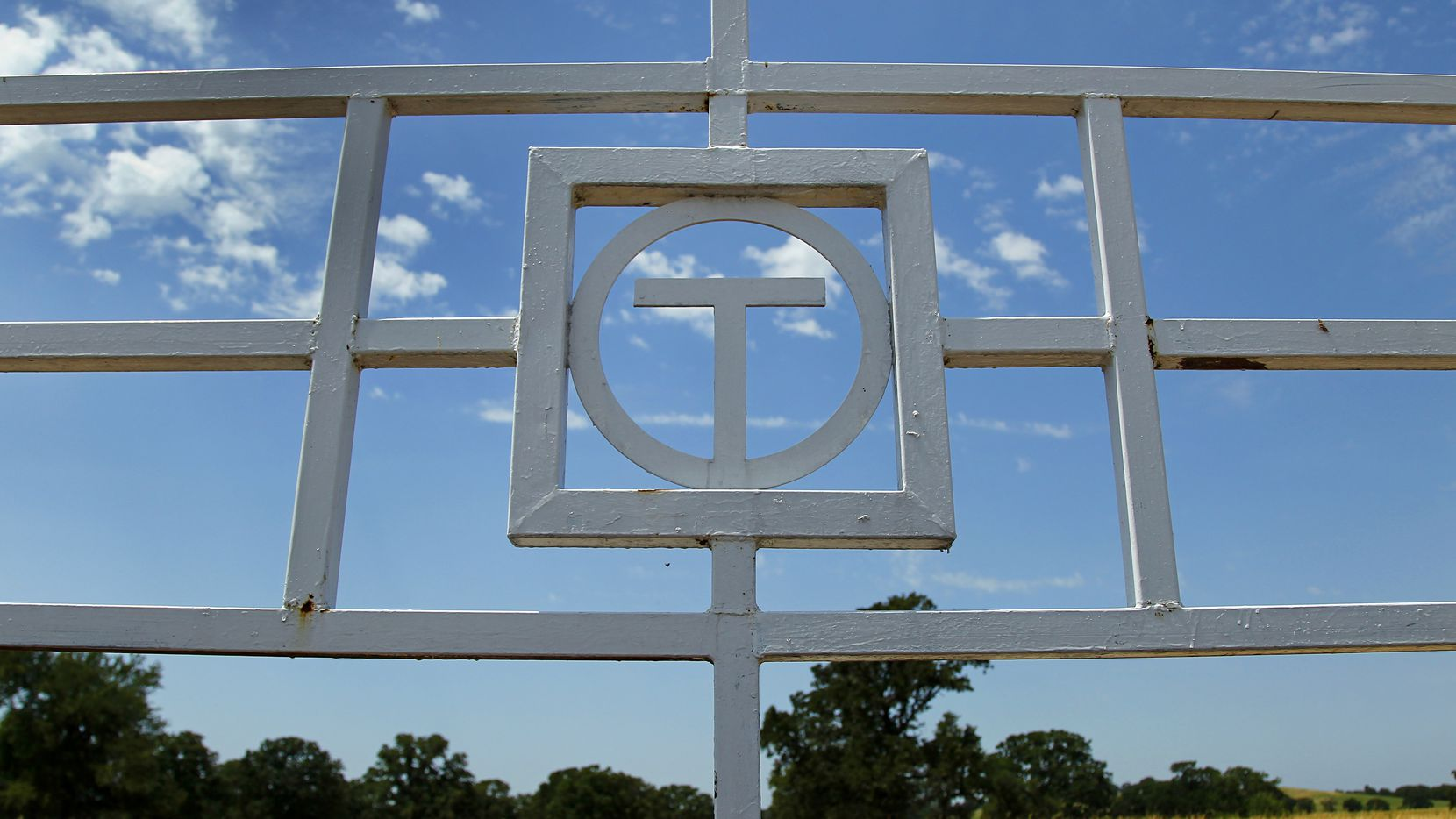 The Circle T Ranch brand is seen on a cattle gate in Westlake.