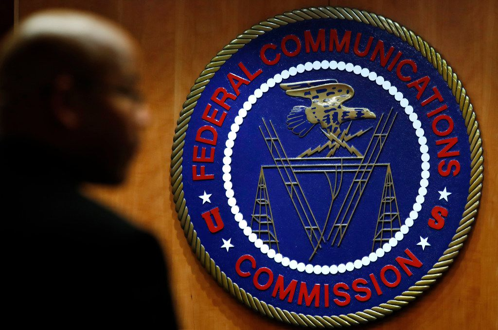 "FILE- This Dec. 14, 2017, file photo, shows the seal of the Federal Communications Commission (FCC) before a meeting in Washington. Your ability to watch and use your favorite apps and services could start to change, though not right away, following a formal repeal of Obama-era internet protections on Monday, June 11, 2018. The repeal takes effect six months after the FCC voted to undo ""net neutrality"" rules that had barred broadband and cellphone companies from favoring their own services and discriminating against rivals such as Netflix. (AP Photo/Jacquelyn Martin, File)"