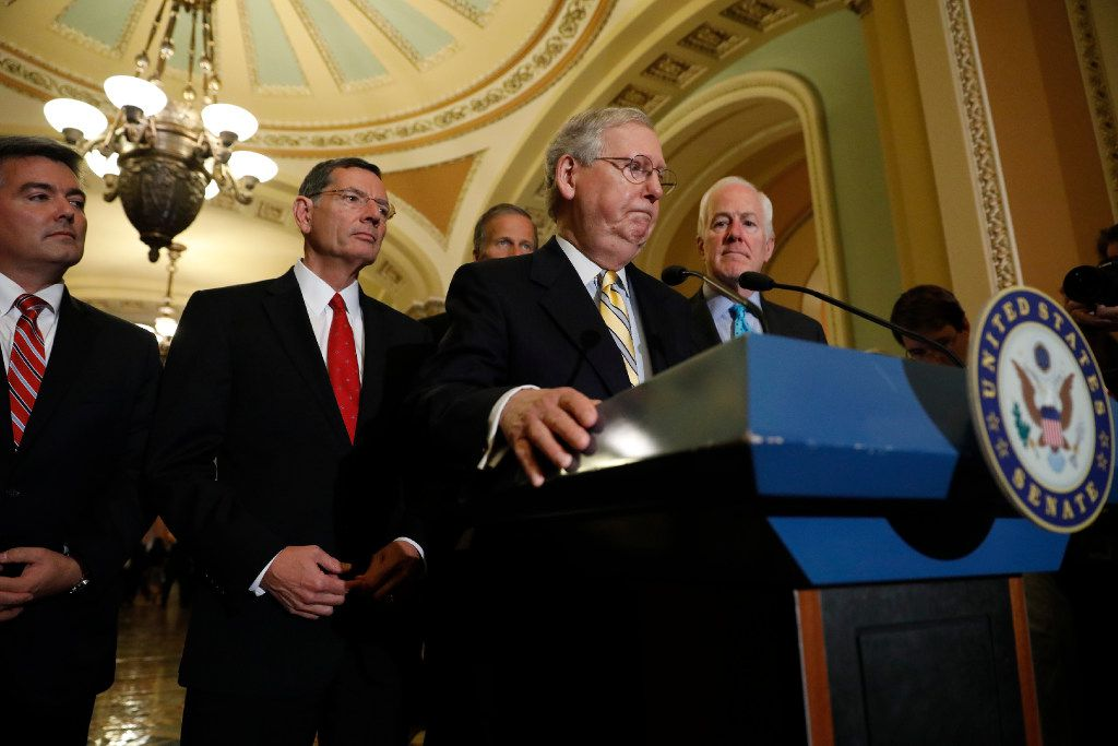Senate Majority Leader Mitch McConnell (at lectern) of Kentucky, accompanied by (from left) Sen. Cory Gardner of Colorado, Sen. John Barrasso of Wyoming, Sen. John Thune of South Dakota and Sen. John Cornyn of Texas speaks with reporters after the weekly Senate Republican policy luncheon at the U.S. Capitol.