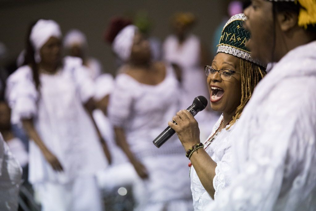 Ifaronki Fagbenro Amusam sings during a memorial service for Arthur Riggins, also affectionately known as Baba and Chief Ifayomi by the community, on May 19, 2017, at the Frederick Douglass Community Center in Dallas, Texas. Riggins was a chief in the West African religion of Ifa and his service followed it's traditions. (Andrew Buckley/Special Contributor)
