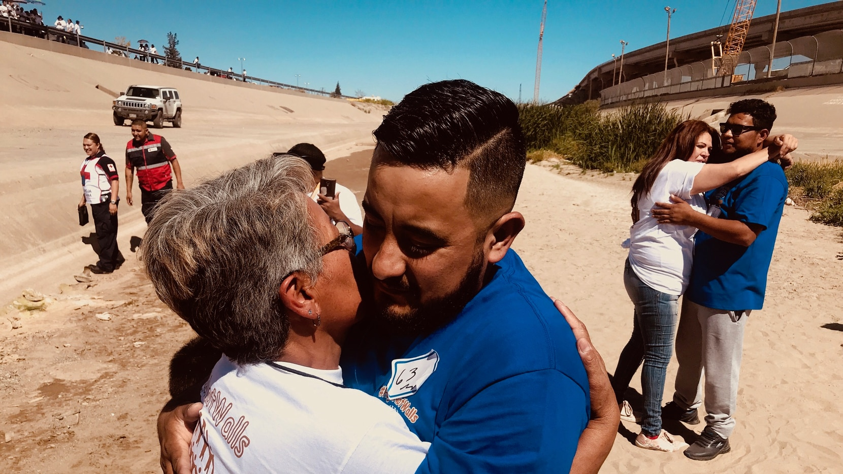 Erik Jimenez and Ana Maria Zavala hugged each other for the first time in 17 years. They were reunited Saturday on the dividing line between the United States and Mexico.