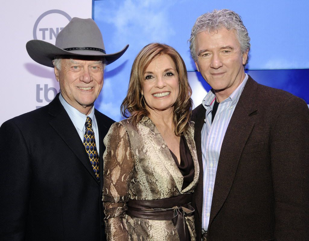 Actors Larry Hagman, left, Linda Gray and Patrick Duffy from the show Dallas attend the TNT and TBS upfront presentation at the Hammerstein Ballroom, in 2012 in New York.