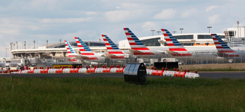 American Airlines airplanes parked at DFW International Airport on Wednesday, August 23, 2017.