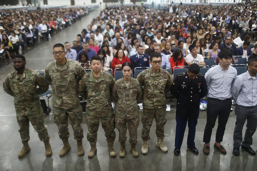 U.S. military members stand after becoming U.S. citizens at a naturalization ceremony on July 25, 2018, in Los Angeles.