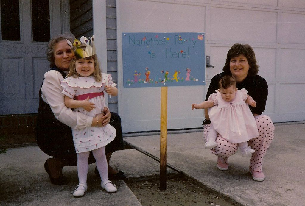 Nancy McCall (left), Nanette Light's grandmother, hugs Nanette (second from left) at her third birthday party in 1990.