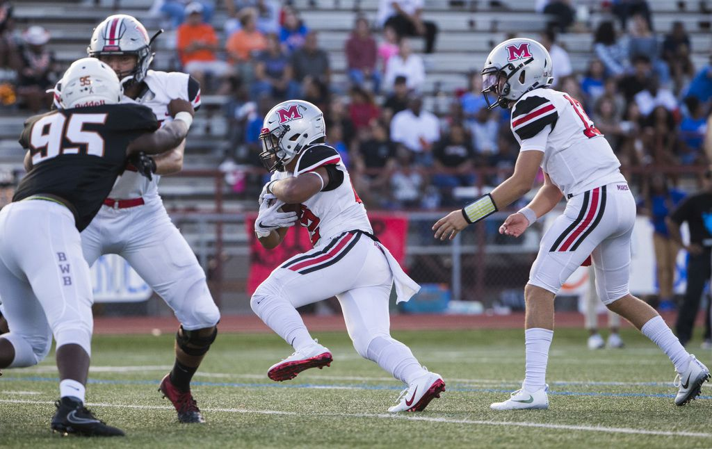 Flower Mound Marcus running back Ty'son Edwards (22) runs to the end zone for a touchdown during the first quarter of a high school football game between Flower Mound Marcus and Arlington Bowie on Thursday, August 29, 2019 at Wilemon Field in Arlington. (Ashley Landis/The Dallas Morning News)